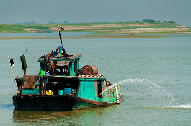 Green boat on Irrawaddy river Green boat on Irrawaddy river close to Mandalay Burma Myanmar myitkyina photos stock pictures, royalty-free photos & images