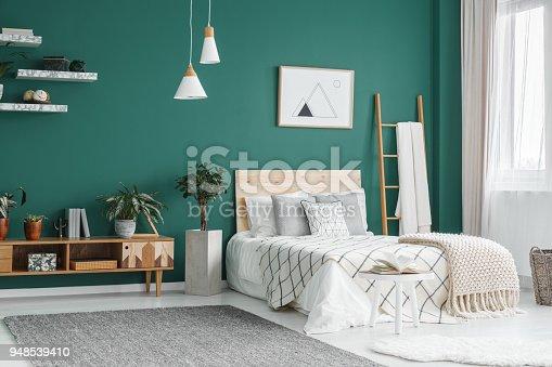 istock Green boho bedroom interior 948539410