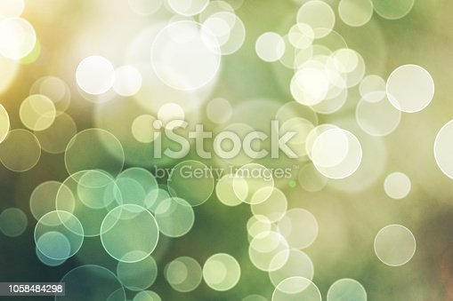 istock Green Bokeh Lights Abstract Background 1058484298