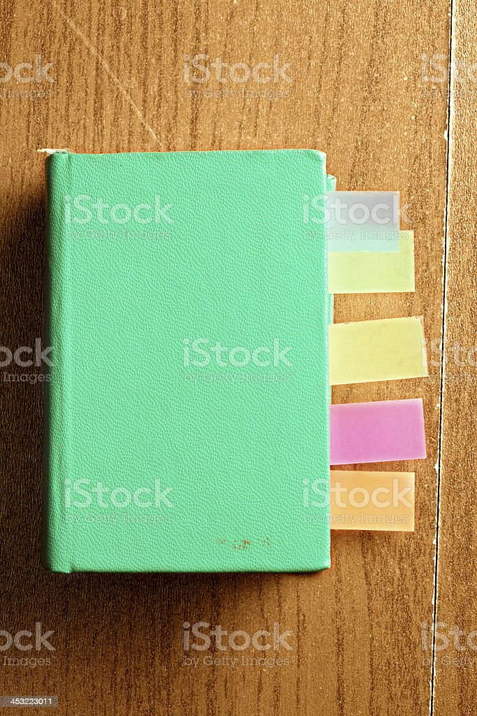Green book with bookmarks stock photo