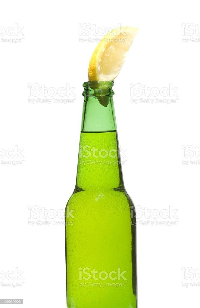 Green Bottle and Lemon royalty-free stock photo