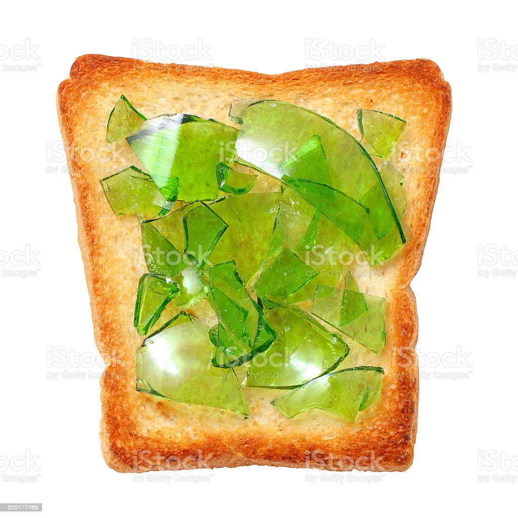 green bottle glass on toasted bread stock photo
