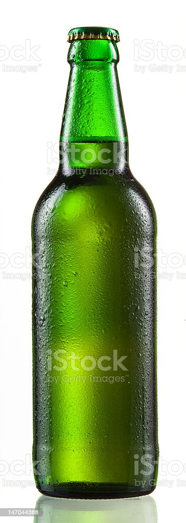 Green bottle of beer with drops stock photo