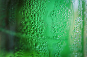 Green bottle with condensation