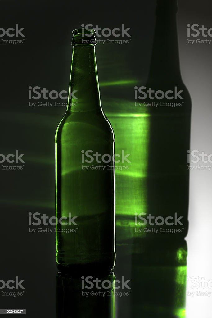 green bottle with colored reflection stock photo