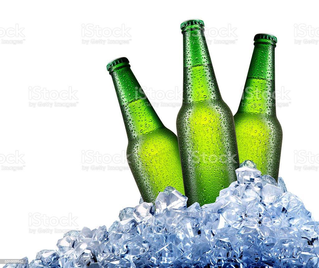 Green bottles in ice stock photo
