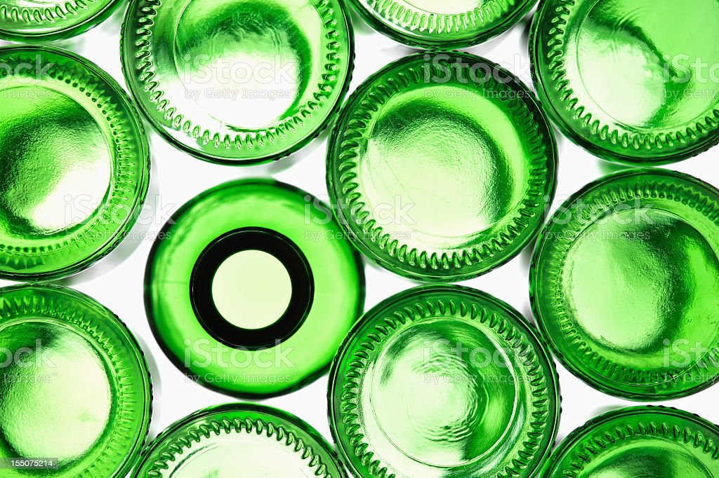 Green bottles with light shining through stock photo