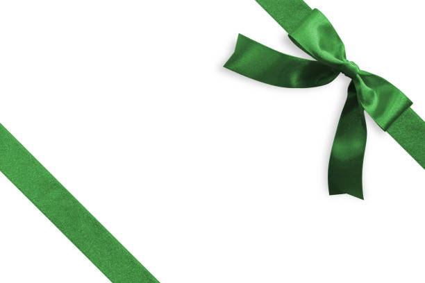green bow satin ribbon band stripe fabric emerald jade color on corner (isolated on white background with clipping path) for christmas holiday gift box present wrap design decoration ornament element - avvolgere foto e immagini stock