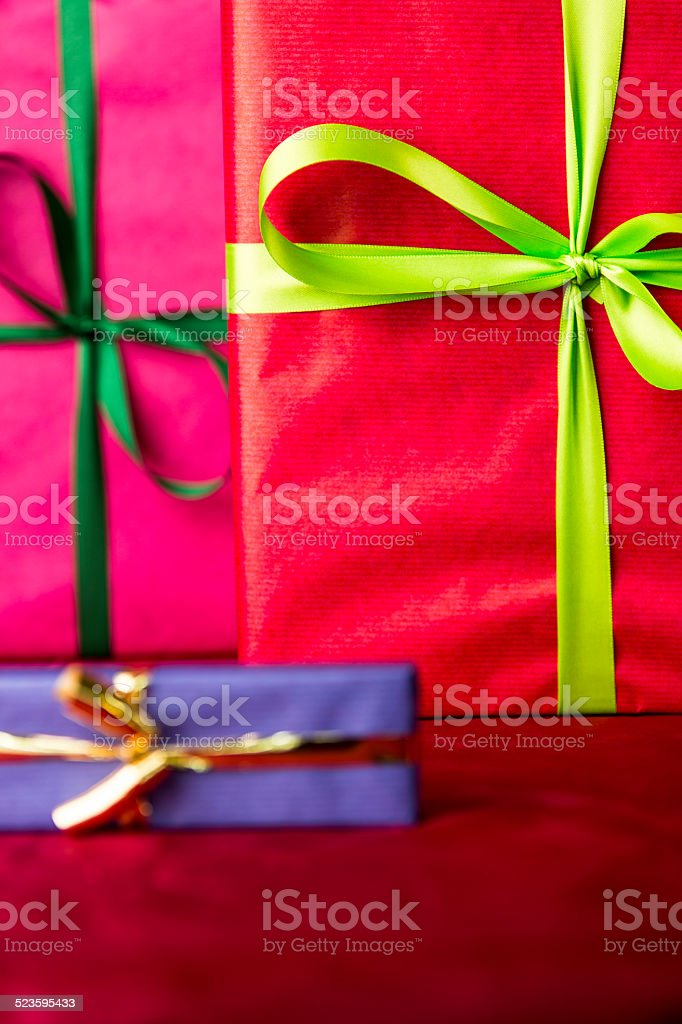 Green bowknots on red gift wrapping. stock photo