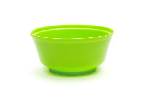 Green bowl for fruits and vegetables on a white background