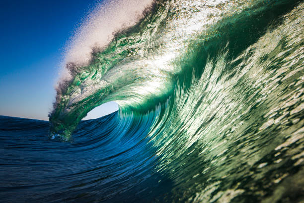 Green breaking wave stock photo