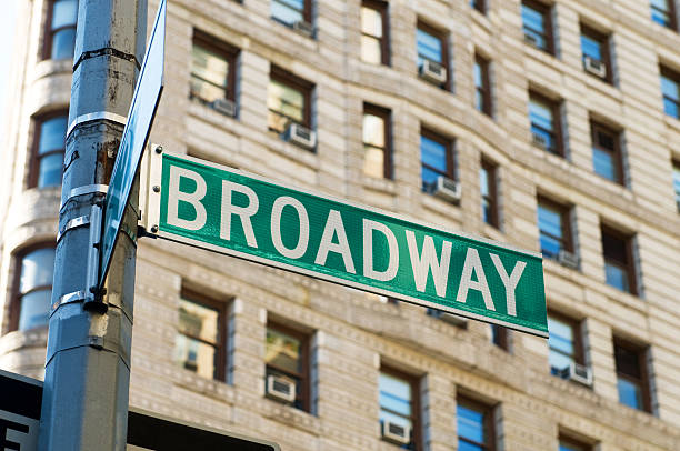 Green Broadway street sign on a post in New York city stock photo