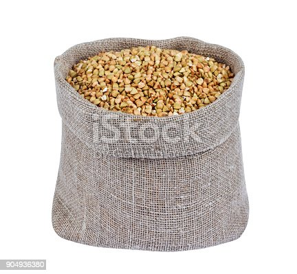 istock Green buckwheat in burlap bag isolated on white 904936380