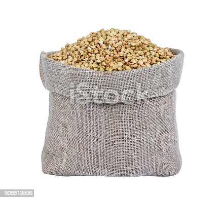 istock Green buckwheat in burlap bag isolated on white 908313596