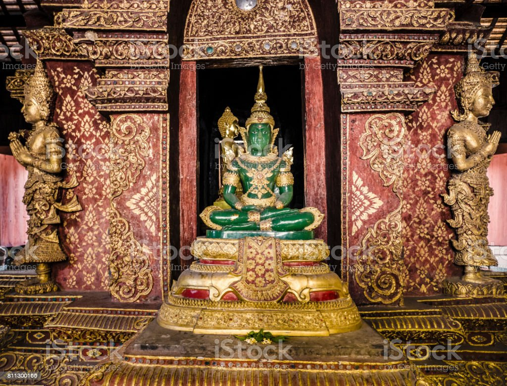 Green Buddha statue in Phra Singh Temple Chiang Mai Thailand stock photo