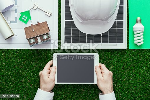 904490858 istock photo Green building and alternative energies 587185870