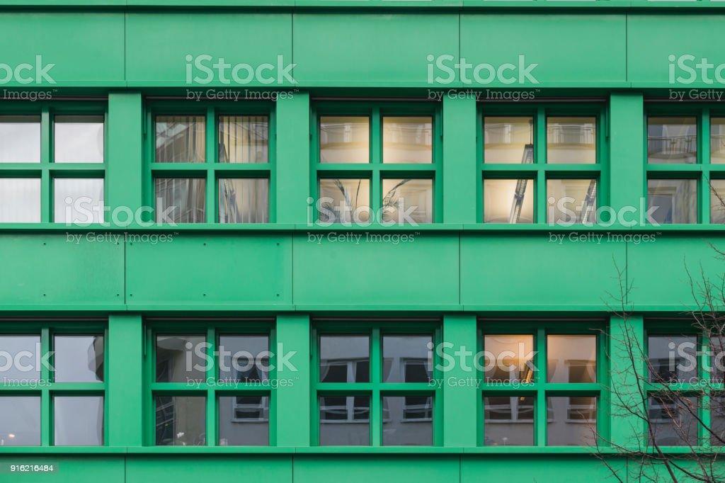 green bulding windows stock photo