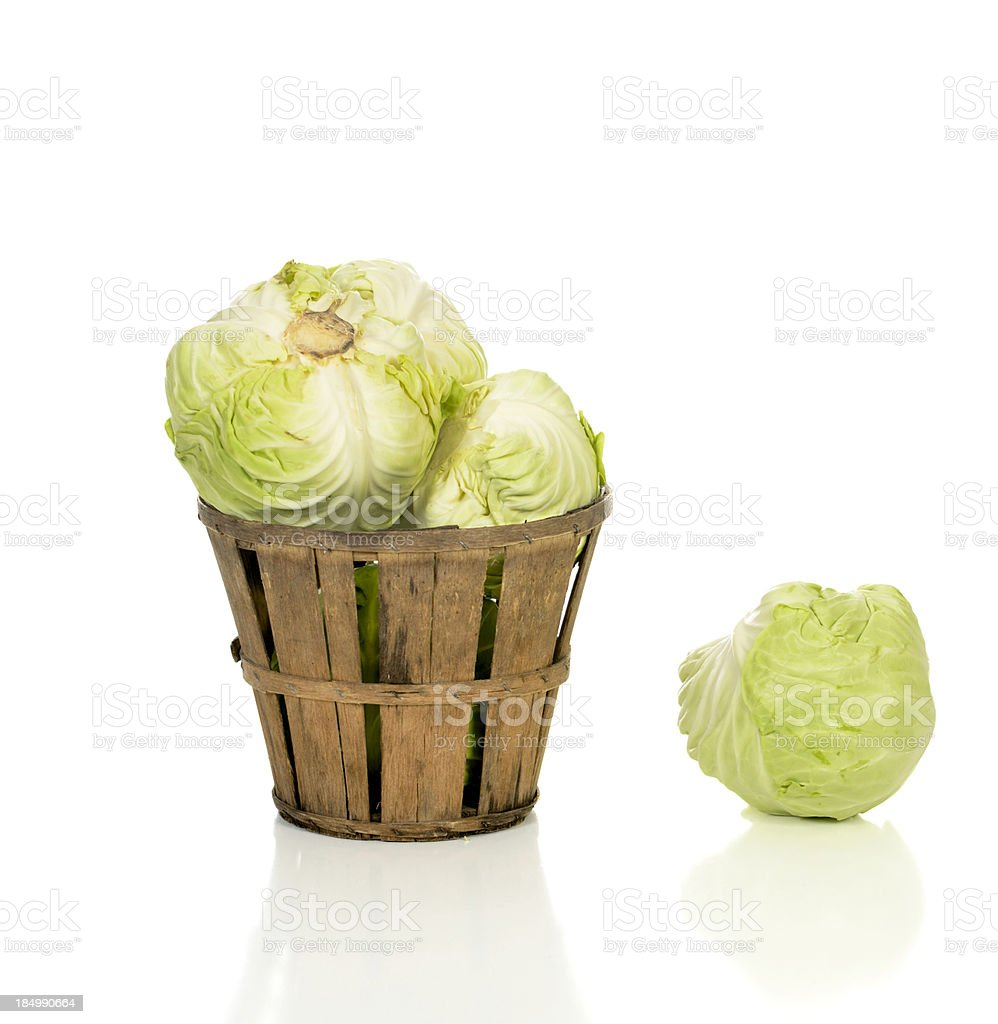 Green Cabbage in a Rustic Basket stock photo