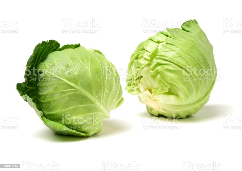 Green cabbage  on a white background stock photo
