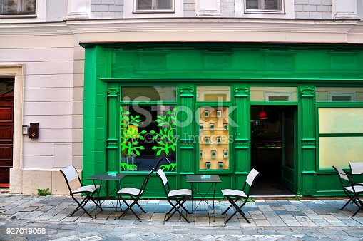 Romantic retro Green cafe on a small city street