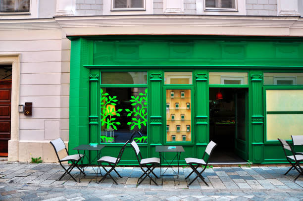 green cafe on a small street - store stock pictures, royalty-free photos & images