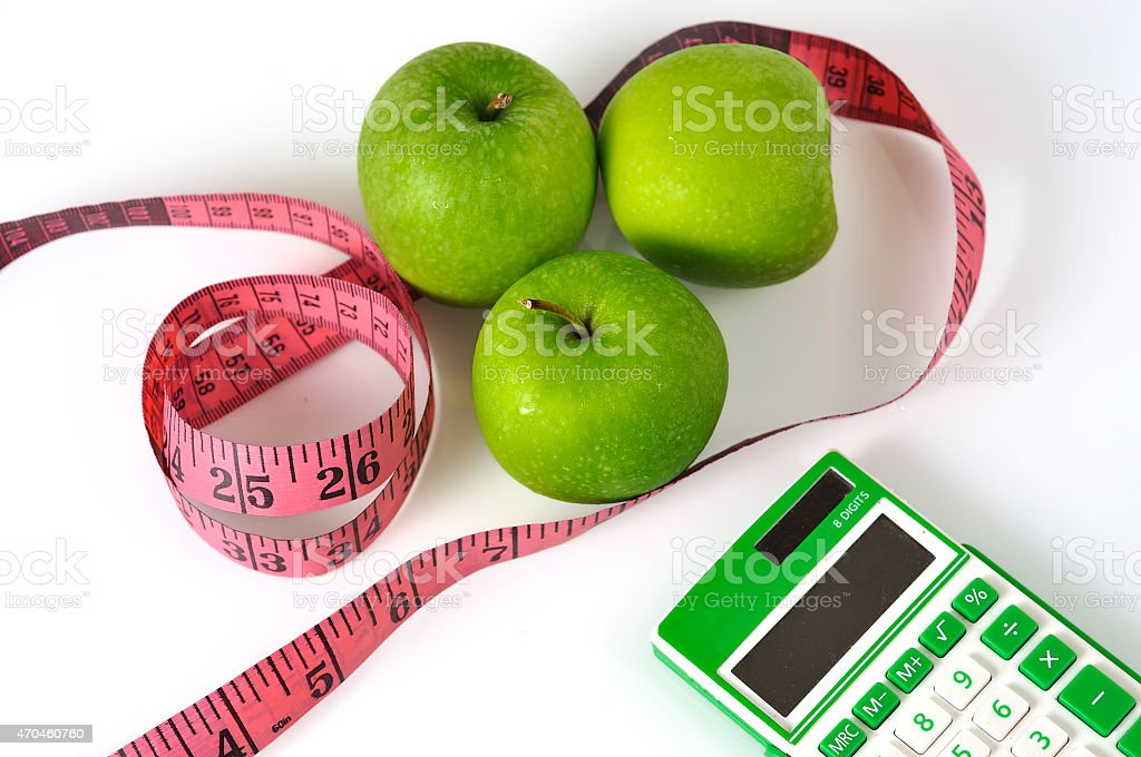 Green calculator with Green Apple and Measure Tape stock photo