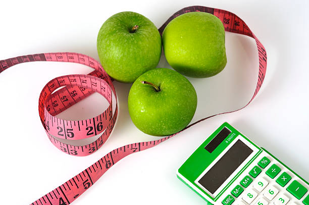 Green Rechner mit grünen Apfel und Maßnahme Klebeband – Foto