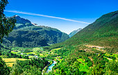 View on green calley landscape and mountain creek in Norway