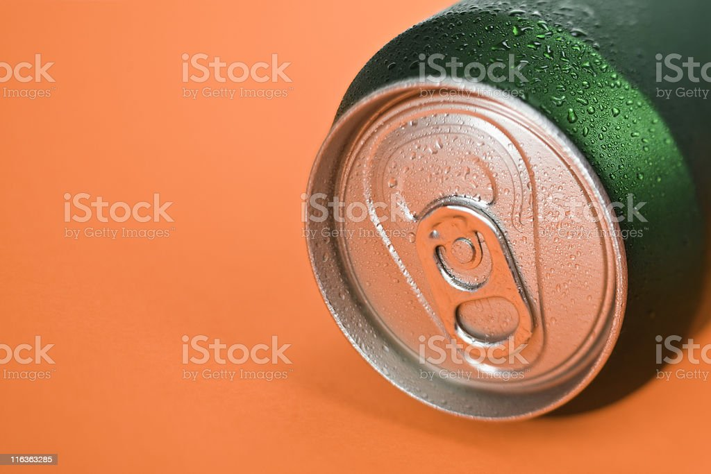 Green Can On Orange stock photo