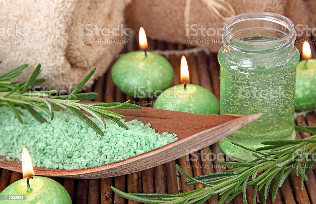 Green candles and bath salts on bamboo slats royalty-free stock photo
