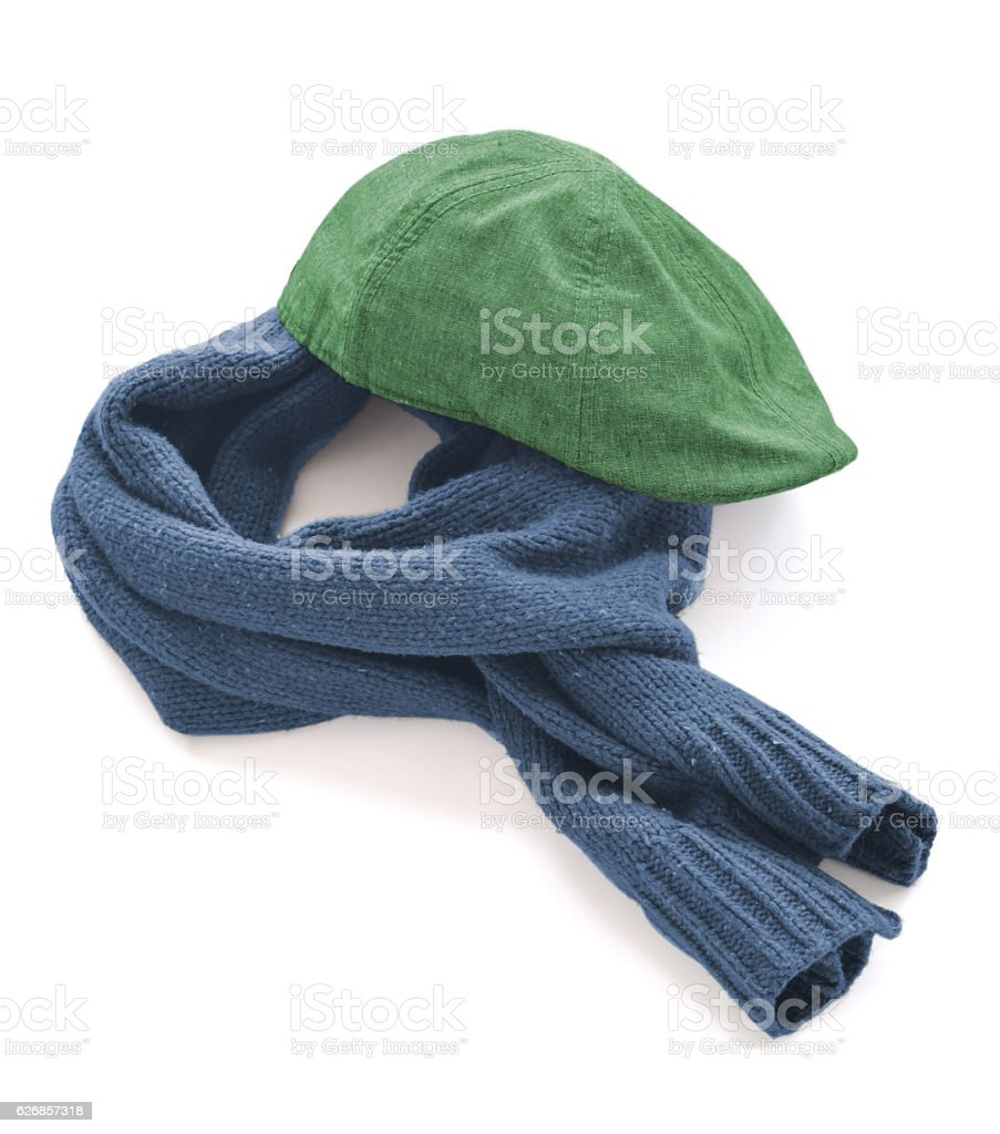 1bf4fb8e5cb70 Green cap and blue warm scarf on a white background royalty-free stock photo