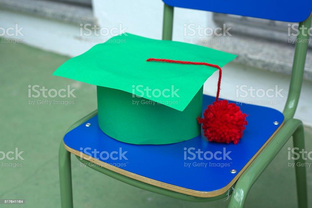 Green cap during nursery graduation day stock photo