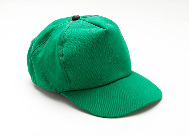 Green Cap Green Cap baseball cap stock pictures, royalty-free photos & images