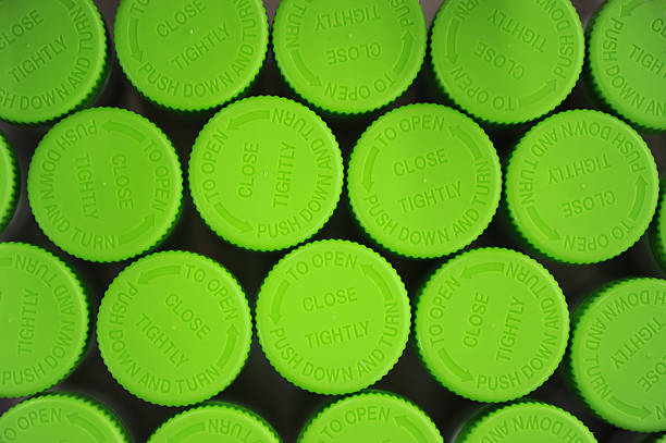 green caps - plastic cap stock pictures, royalty-free photos & images