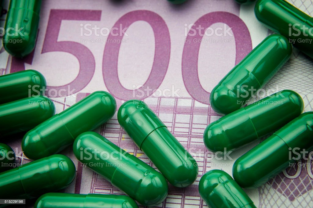 green capsules up ticket of 500 euros stock photo