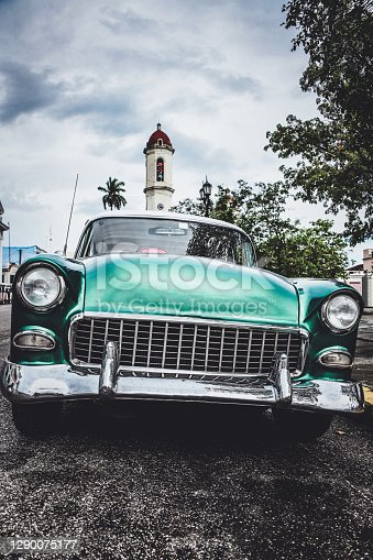 istock Green Car Near Our Lady of the Immaculate Conception Cathedral In Cienfuegos, Cuba 1290075177