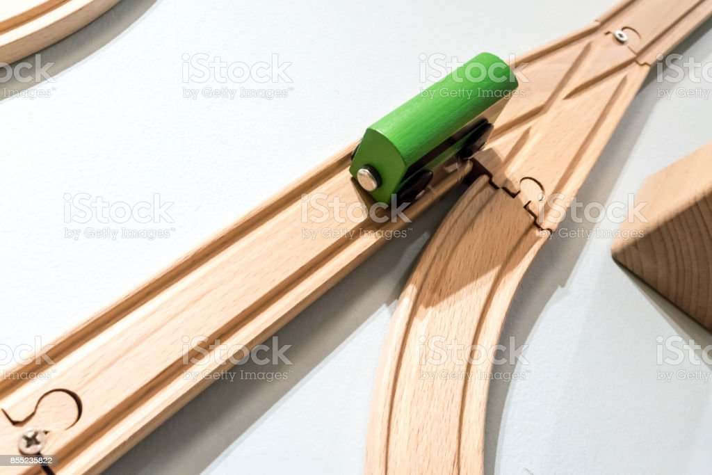 Green car toy on wooden track isolated on white background stock photo