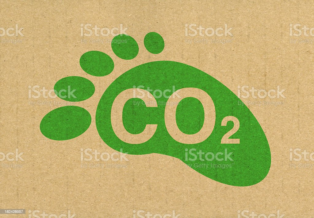 Green carbon footprint titled CO2 on recycled brown paper stock photo