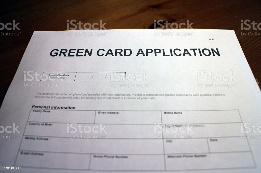 Someone filling out Green Card Application Form.