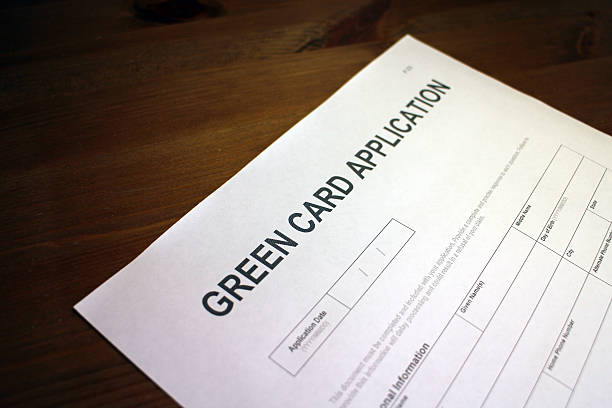 Green Card Application Form Someone filling out Green Card Application Form. green card stock pictures, royalty-free photos & images
