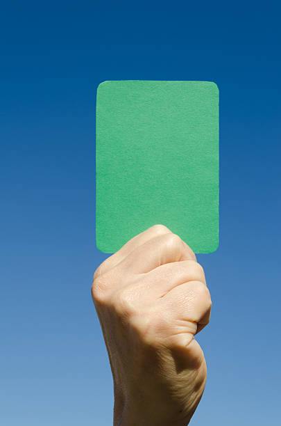 Green card A green card in the hand against blue sky. green card stock pictures, royalty-free photos & images