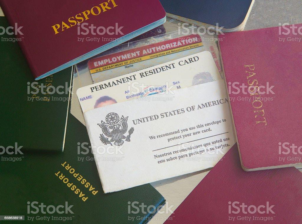 Green card with passports Green card with passports Airport Stock Photo