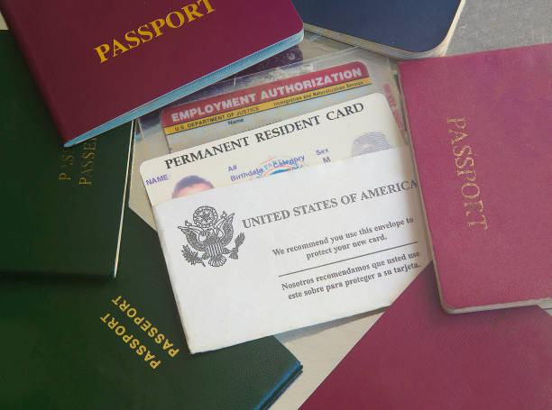 Green card with passports Green card with passports citizenship stock pictures, royalty-free photos & images