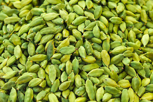 Green cardamom Pods of green cardamom in a pile cardamom stock pictures, royalty-free photos & images