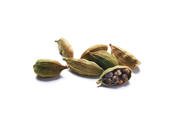 green cardamom green dry seeds of cardamom isolated on white background cardamom stock pictures, royalty-free photos & images