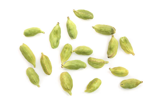 Green cardamom seeds isolated on white background. Top view. Flat lay Green cardamom seeds isolated on white background. Top view. Flat lay. cardamom stock pictures, royalty-free photos & images
