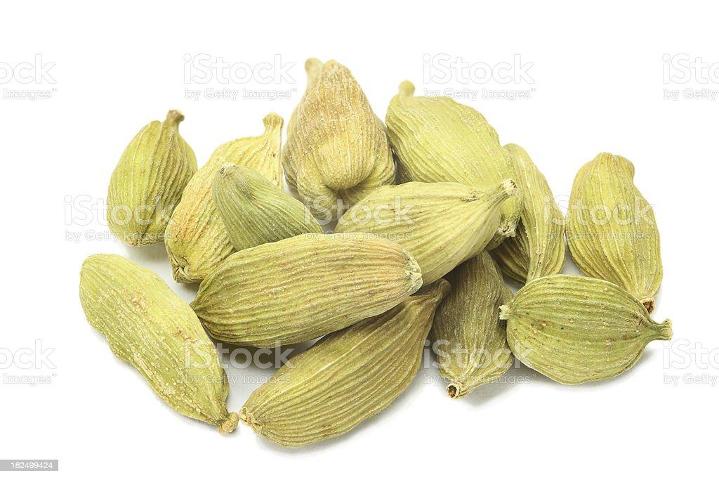 green cardamom seeds (elettaria cardamomum) isolated on white royalty-free stock photo