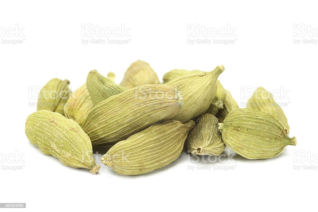 green cardamom seeds (elettaria cardamomum) isolated on white stock photo