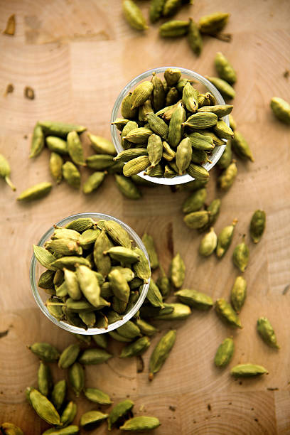 green cardamoms Green cardamoms cardamom stock pictures, royalty-free photos & images