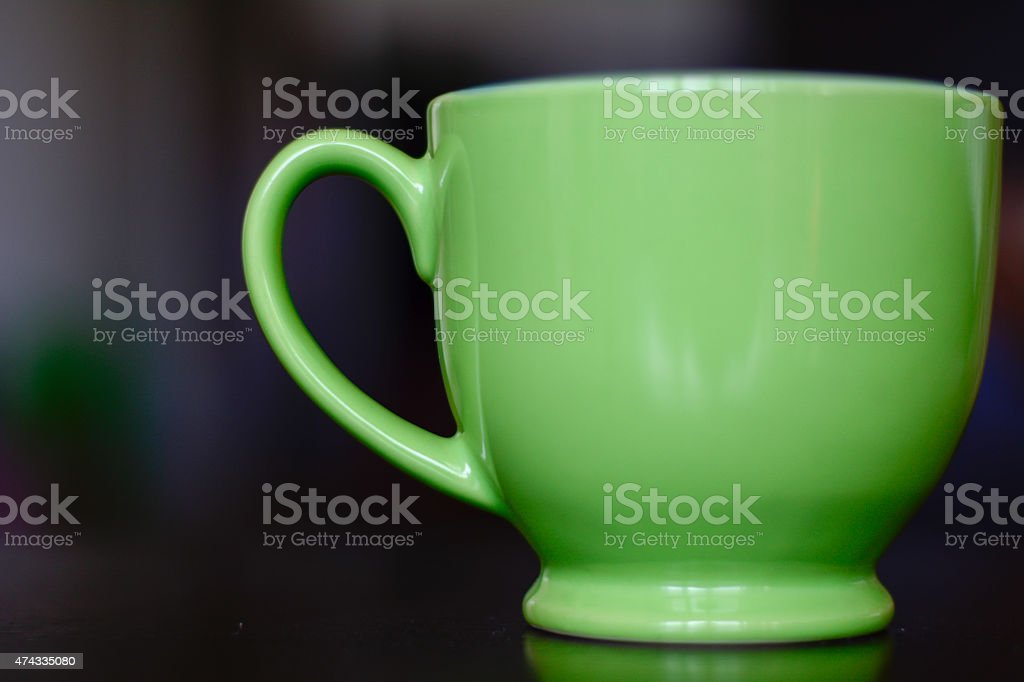 Green ceramic coffee cup stock photo